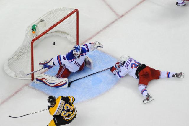 Brad Marchand scores the game-winning overtime goal against Henrik Lundqvist